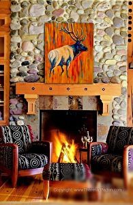 """Elk at Sunrise"" painting by Theresa Paden, displayed in an interior."