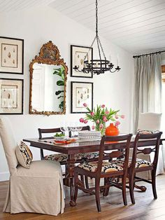 I like the look of two skirted Parsons chairs with lumbar pillows that match the seats of the wooden side chairs.