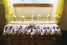 DIY TOMS shoes. I made label covers with my wedding colors with embodied nicknames for each of my bridesmaids. I also made champagne glasses with their nicknames too.   Bridesmaids gifts. :)  Photographer- Deidre Lynn Photography