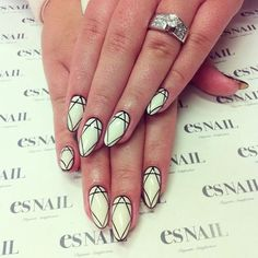 A simple and classy abstract nail art design. The matte white base color suits the theme as thin black lines are drawn in pattern on top.