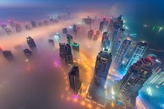 Photographer Daniel Cheong's photos of Dubai's foggy, colorful nights give a unique perspective on the on one of the United Arab Emirates fast-rising cities : From up above it all. Cheong goes up the city's tall buildings and in helicopters to capture the stunning views of the city, and brings them to life with some careful editing after.