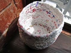 all those bags you never remember to return to the store to recycle... upcycled into wastebaskets (could do a rug?)
