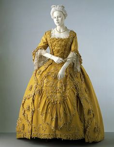 Sack-back gown, Britain. From the 17th century to the late 19th century, most women had at least one pair of pockets, which served a similar purpose as a handbag does today. There are no pockets visible on this woman's ensemble. They were usually worn underneath their petticoats.