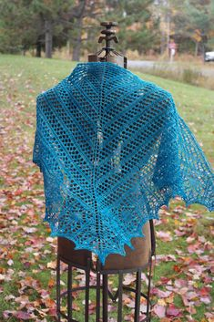 A pretty, airy, shawl for Spring! -- knit from a single skein of one of my favorite yarns, Skinny Bugga. The body of the shawl is knit entirely from written instructions and consists primarily of an easy 10 row repeat ; only the lace edging is charted. Stitch counts are available to keep on track :-)
