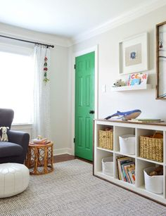 With the crib finally gone, we've updated this space to be a new big boy bedroom - complete with built-ins, a daybed, and plenty of play space.