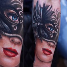 Girl mask tattoo.