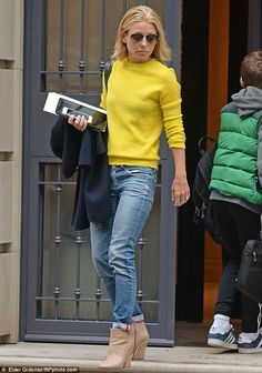 Casual look: The former soap opera actress was dressed down in a yellow sweater and worn-i...