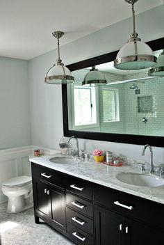 herringbone marble tiles, subway tiles for shower, lt grey walls, black mirror/cabinet