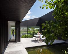 TV House is Made Up by Different Volumes Centered Around a Green Space
