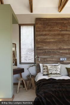 Like the rustic wood behind the bed. Brings character to the room.