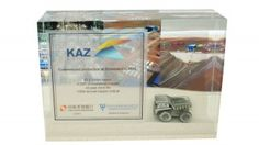 Custom Acrylic with embedded pewter mining truck marking the opening of a site by Kazakh copper producer Kaz Minerals.
