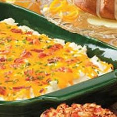 """""""Everything"""" Mashed Potato Casserole ~ Great to take to a covered-dish event.  Or place the mixture in a crockpot and then add the sour cream, bacon, cheese and chives."""