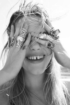 What a beautiful finger party this girl is having! Those rings! And that tooth gap--couldn't be more lovely.