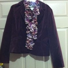 Tommy Hilfiger blazer Maroon (purple) lined velour blazer. One button  in front , collared. Long sleeve very,very nice blazer. Heavy well made. Pockets on front are decorational. Stretch size XL . Cotton/spandex poly blend . No stains smoke free . Great business piece . Tommy Hilfiger Jackets & Coats Blazers