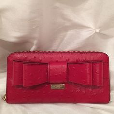 Kate Spade wallet Bright, bold and bowed!  This is a great wallet with multiple compartments. Never used. I am not leaving it in PM  too long. kate spade Bags Wallets