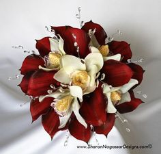 I LOVE THIS!   sharon nagassar designs silk, latex, real touch, custom wedding flowers - Red Burgundy Calla lilies and white off-white cymbidium orchids