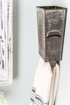Antique Box Grater Towel Rack + A Touch of Farmhouse Charm   http://blesserhouse.com - A repurposed antique box grater towel rack plus more DIY project ideas for a farmhouse style home from the book A Touch of Farmhouse Charm.