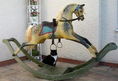Love this antique rocking horse & love the cat!