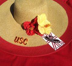 ONLY ONE LEFT of the ladies custom USC sun hat!  The product in the bookstore and on our webpage comes without the hibiscus.   Check it out, ladies - only two weeks until Season Kickoff!