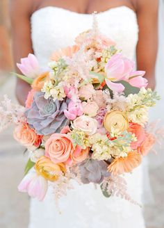 10 Insanely Pretty Spring Wedding Bouquets: Tulips and succulents take this bouquet from beautiful to breathtaking.  Photography by Gema; Floral by La Tee Da Flowers