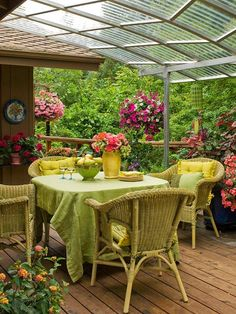 Clear porch cover, could add a temporary cloth curtain for afternoon luncheons. Lovely.
