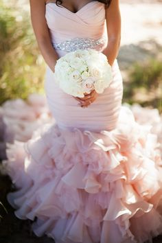 Blush wedding dress perfect for an offbeat yet classic bridal look!