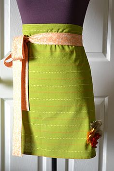 Holiday dish towel apron--a dish towel and fabric or ribbon become an apron.  Could do Christmas, Valentines', etc.--just find a festive towel.