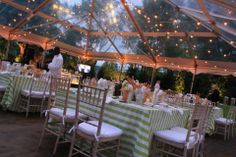 Striped #green and #white #tablecloths that looked beautiful in the lush evening setting of this outdoor #wedding. #realweddings #events #eventplanning #greenweddingideas #realevents #decor #tablescape