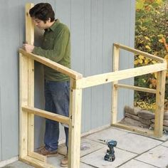 Mark Powers building the back crosspiece for his trash shed
