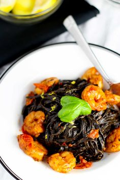 Spanish style scampi with squid ink linguine. JEN edits: double the tomato paste and the white wine. :) Also make sure you have at least one 'overflowing' cup of FRESH chopped basil and stir it in when you stir the pasta into the sauce.
