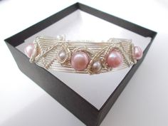 Hey, I found this really awesome Etsy listing at https://www.etsy.com/listing/249193224/pearl-bracelet-wire-wrapped-jewellery