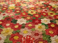 Grandma's Flower Garden. I think this may be the prettiest quilt I have ever seen! d
