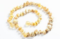 Teething necklace for baby. Healing raw amber bead. White amber jewelry.