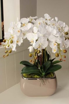 Potted Orchid Centerpiece, Orchid Flower Arrangements, Beautiful Flower Arrangements, Beautiful Flowers, White Orchids, White Flowers, Orquideas Cymbidium, Artificial Orchids, House Plants Decor