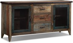 Roan Cabinet - This unique piece accentuates the look of any room with its rustic, industrial charm. The multicolored lacquer finish on pine and the iron bands and nailhead trim offer a contemporary look with lots of storage space.