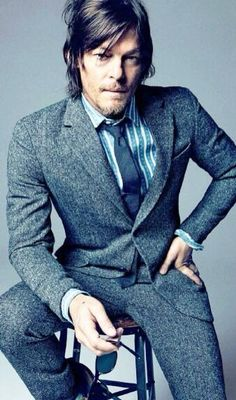 I like the fact that his hair is mussed. Norman in a suit is ok but he wears less better. Than anyone