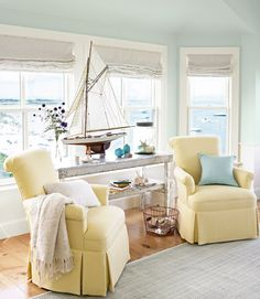 In this master bedroom's sitting area, a pair of chairs covered in cotton matelassé swivel to face the harbor.