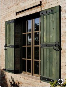 Check it out - These classic shutters have a colonial vibe - painted forest green seen here in great contrast with the brick facade. Window Shutters Exterior, Outdoor Shutters, Cedar Shutters, Rustic Shutters, House Shutters, Diy Shutters, Classic Shutters, Wooden Window Shutters, Bedroom Shutters