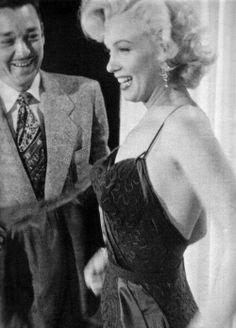 "Marilyn Monroe with designer, William Travilla, during a wardrobe test for ""Gentlemen Prefer Blondes"", 1953."