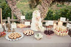 This dessert table, styled by Los Angeles-based Gather Events, uses a gray tablecloth as a backdrop. Notice how it complements the blush-colored flowers and cake trays.