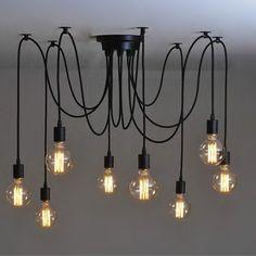 Lámpara araña de 10 brazos tipo retro vintage. Cables y portalámparas de goma. https://www.lamparas.es/retro-vintage/3059-lampara-arana-retro-10brazos.html