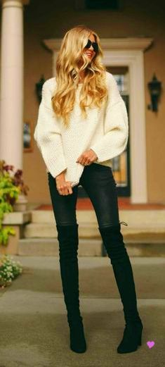 thigh high boots. This girl is rocking the boots, but I think I would look like a stripper if I wore thigh highs