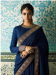 Want to check out best full neck blouse designs of this year? Here are 23 latest models you can wear with any saree! Want to check out best full neck blouse designs of this year? Here are 23 latest models you can wear with any saree! Blouse Back Neck Designs, Sari Blouse Designs, Saree Blouse Patterns, Latest Blouse Designs, Golden Blouse Designs, Neckline Designs, Trendy Sarees, Stylish Sarees, Sari Bluse