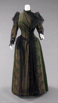 1889 American designed silk and metallic threaded dress by Uoll Gross. MET.