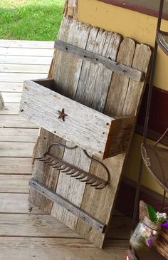Wine rack made from old rake and old wood fence.