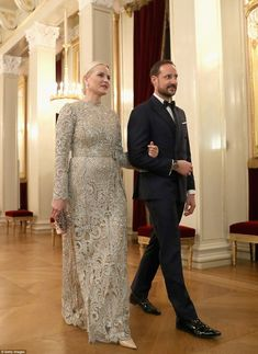 Crown Princess Mette Marit sparkled on her way to dinner in a beautiful silber gown, she was accompanied by Crown Prince Haakon who looked dapper in a double breasted suit