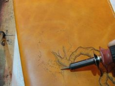 Bookbinding. How to burn the title or design onto a leather book.
