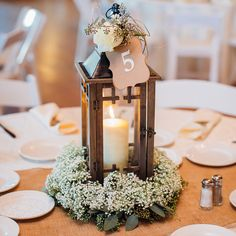 45 Rustic Wedding Decorations You Must Have A Look---lantern candle with baby breath wreath, spring weddings, wedding table. Lantern Centerpiece Wedding, Wedding Lanterns, Rustic Wedding Centerpieces, Wedding Table Centerpieces, Flower Centerpieces, Wedding Decorations, Centerpiece Ideas, Rustic Lanterns, Quinceanera Centerpieces