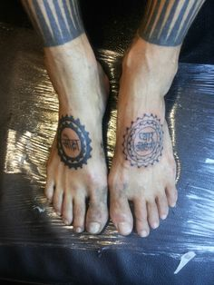 "Foot on right machine done. Foot on left handpoked.  Its reads from left to right in sanskrit ""salvation      love odyssey"""