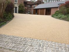 Is your driveway looking old and worn? For a new affordable driveway choose resin bound paving by Surebond Surfaces UK Ltd in Somerset. Cobbled Driveway, Driveway Paving, Stone Driveway, Driveway Landscaping, Outdoor Landscaping, Front Garden Ideas Driveway, Driveway Design, Driveway Entrance, Resin Gravel